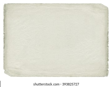 Vintage light paper blank with torn edges isolated on white background. Old texture.
