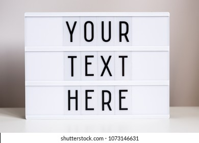 "vintage lightbox with words ""your text here"" on the table"