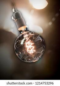 vintage lightbulb with dark background and lens flares
