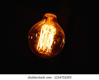 vintage lightbulb with dust on it against  dark background