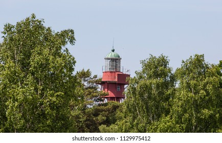 The vintage lighthouse of Sandhammaren, Skane Sweden, in this days in greenery surroundings