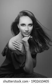 Vintage like black and white studio portrait of a beautiful model