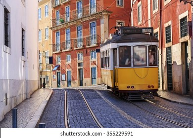Vintage Lisbon tram on city street, sunny day, Portugal