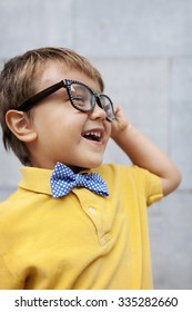 vintage little boy with a bow tie and glasses