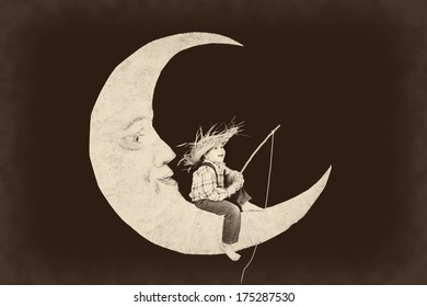 Vintage little boy fishing from a paper moon