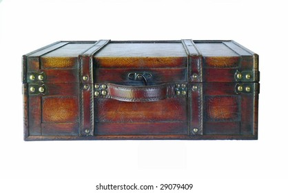 Vintage look decorative leather-bound, nail studded suitcase isolated on white. The suitcase is closed and laying on it's side with the top and leather handle facing the viewer.