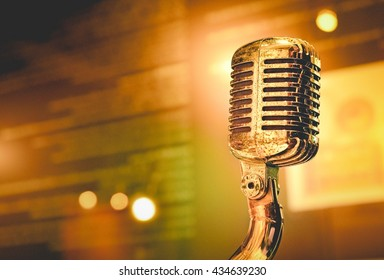 Vintage look filter with place for your text, Retro Microphone On Stage. Close Up and Lighting in Background