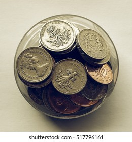 Vintage looking British Pounds coins (UK currency) in a box
