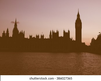 Vintage looking Dark silhouette of Houses of Parliament aka Westminster Palace at night in London, UK