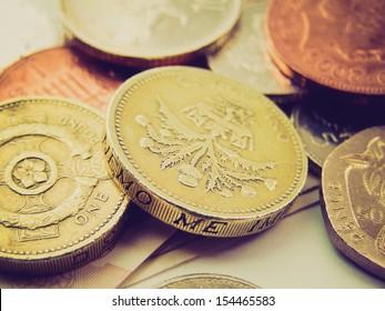 Vintage looking Detail of British Pound GBP coins money