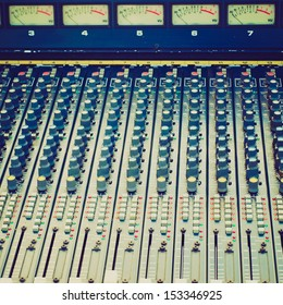 Vintage looking Detail of a soundboard mixer electronic device