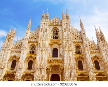 Vintage looking Duomo di Milano meaning Milan Cathedral in Italy, with blue sky
