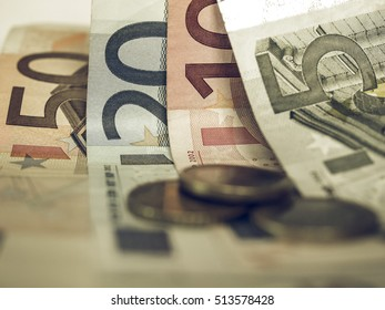 Vintage looking Euro banknote and coin (currency of the European Union)