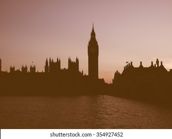 Vintage looking Houses of Parliament aka Westminster Palace at night in London, UK