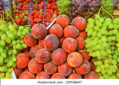 Vintage looking Many fruits including peach uve strawberry on a supermarket shelf