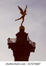 Vintage looking Obelisque in Place de la Bastille square in Paris France