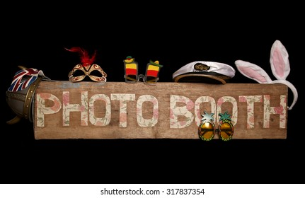 Vintage looking photo booth sign on black background