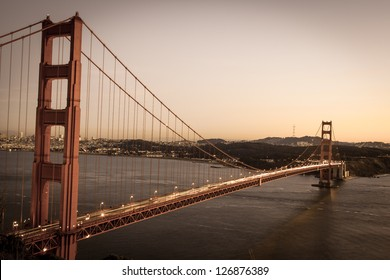 Vintage looking photo of the Golden gate bridge in sunset