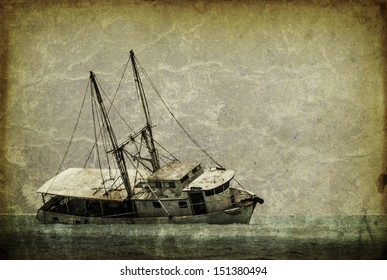 Vintage looking picture of a capsized fishing boat in the caribbean