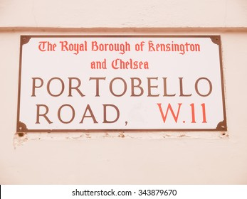 Vintage looking Portobello Road W11 sign in the Royal Borough of Kensington and Chelsea in London UK