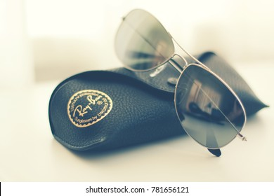 6e229b41965d Vintage looking Ray Ban sunglasses with pouch on a creamy background.