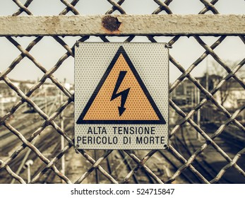 Vintage looking Sign of risk of electric shock by electrocution - in Italian