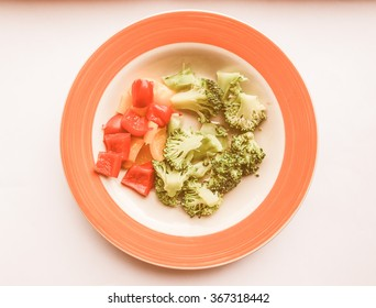 Vintage looking Vegetables dish with broccoli and red and yellow peppers