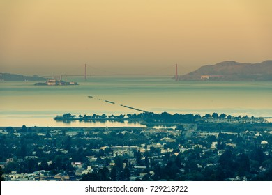 Vintage looking view including the Golden Gate Bridge and Alcatraz Island in San Francisco, California, USA.