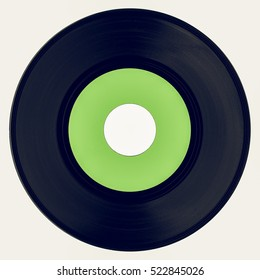 Vintage looking Vinyl record vintage analog music recording medium with blank green label