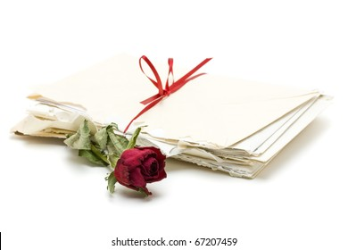 Vintage love letters with red rose over white background