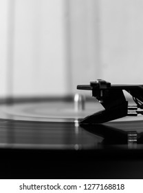 Vintage lp vynil record on a turntable in black and white