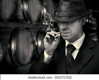 vintage mafia gangster in illegal distillery