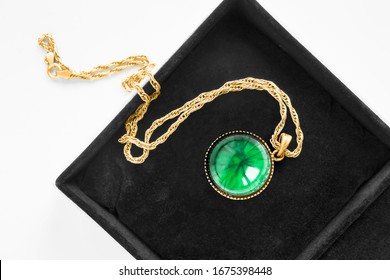Vintage malachite locket pendant on gold chain in black jewel box