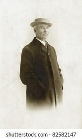 Vintage Man in Overcoat & Hat, noise added