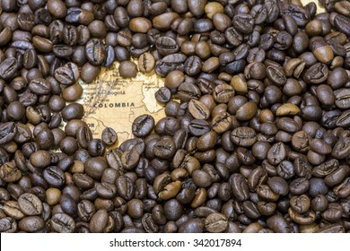 Vintage map of Colombia covered by a background of roasted coffee beans. This nation is the third main producer and exporter of coffee. Horizontal image.