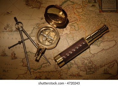 Vintage map with compass and telescope