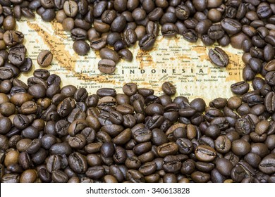 Vintage map of Indonesia covered by a background of roasted coffee beans. This nation is between the five main producers and exporters of coffee. Horizontal image.