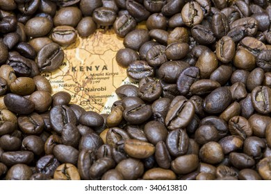 Vintage map of Kenya covered by a background of roasted coffee beans. This nation is one of the main producers and exporters of coffee. Horizontal image.