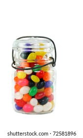Vintage mason jar full of colorful jelly beans on white.