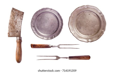 Vintage meat cleaver, forks and plates isolated on white