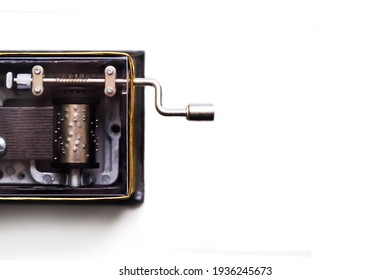 Vintage mechanical music box isolated on white background, top view