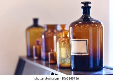 Vintage medicine bottles. Empty scent bottles in old pharmacy
