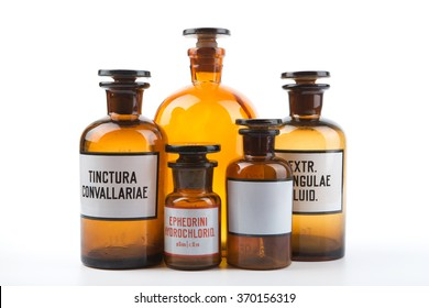 Vintage medicine pharmacy bottles on white background
