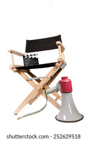 vintage megaphone and clapperboard on directors chair