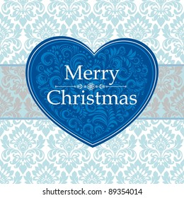 Vintage Merry Christmas Card. Blue heart with flower pattern. Seamless background.