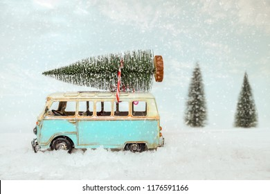 Vintage Merry Christmas postcard background - Miniature antique car carrying christmas tree on roof in snowy winter forest.