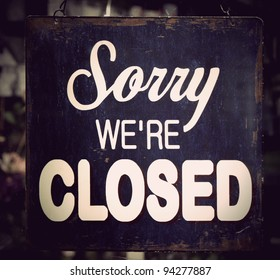 Vintage metal closed sign on shop door