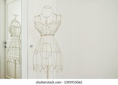 Vintage metal clothing mannequin display in interior girl's room closeup