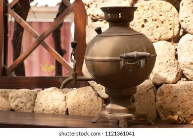 Vintage metal copper tea samovar. Samovar side view.