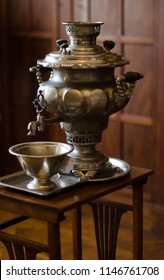 Vintage metal copper tea samovar. Samovar side view in the interior